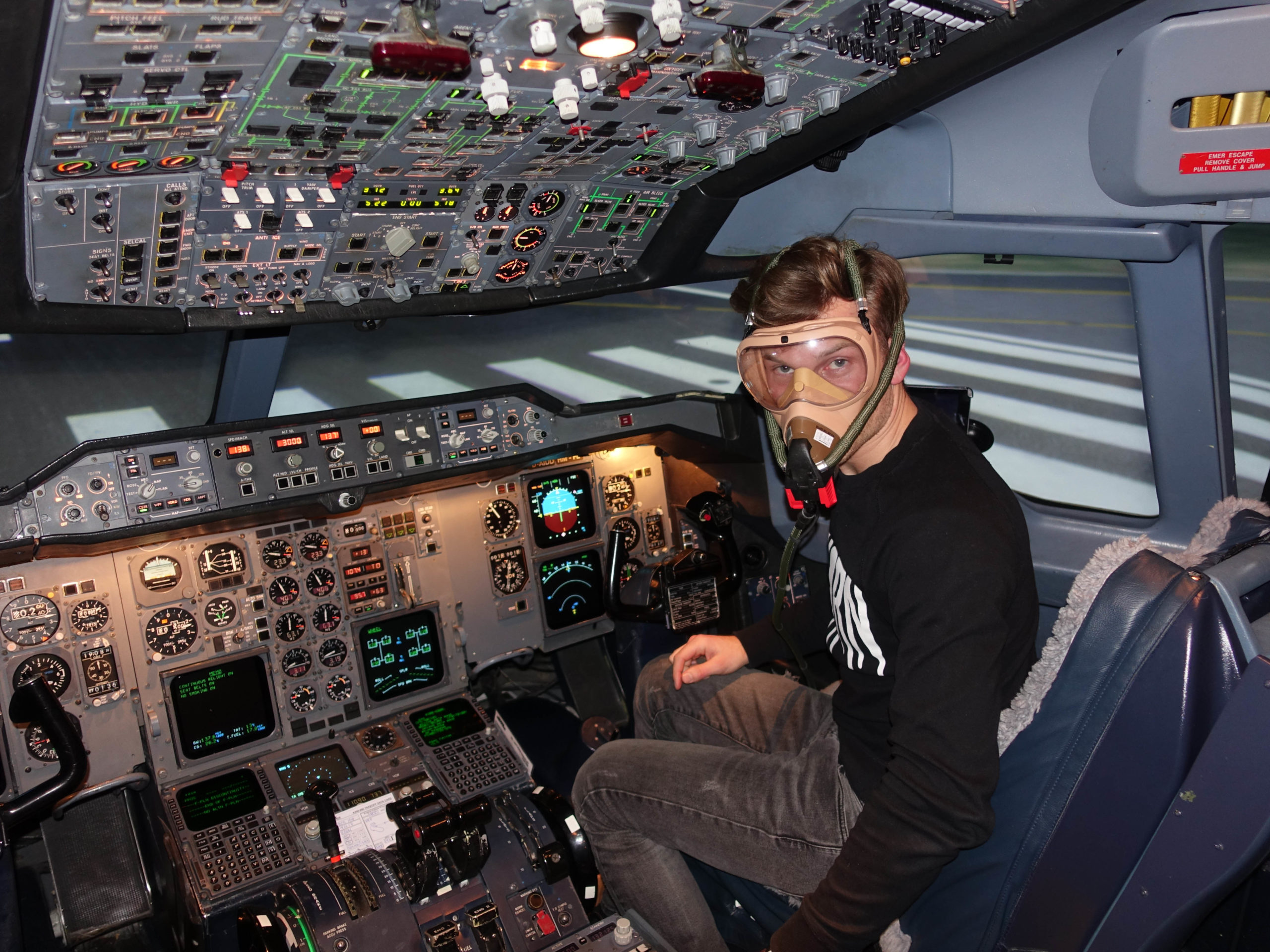 Pilot Patrick A300 simulator cockpit with oxygen mask